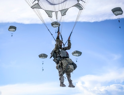 Paratroopers from the 4th Brigade Combat Team (Airborne), 25th Infantry Division, jump from a C-17 onto Andersen Air Force Base, Guam, on June 30 2020. (DoD)