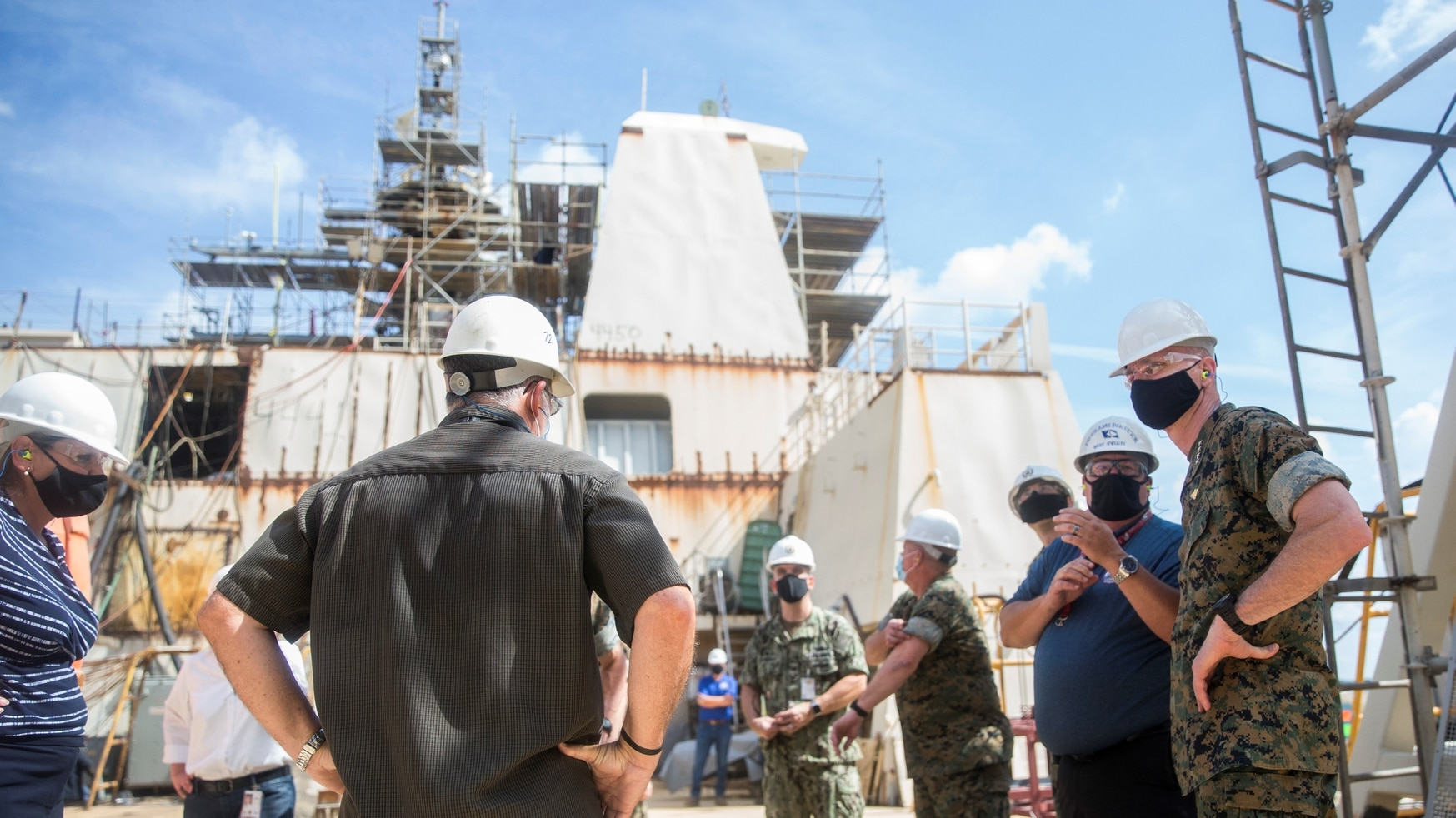 Assistant Commandant of the Marine Corps Gen. Gary Thomas receives a tour of the Huntington Ingalls Industries shipyard in Pescagola, Miss., on Aug. 13, 2020. He was assessing capabilities and production of multiple Navy and Marine Corps projects during the novel coronavirus pandemic. (Sgt. Wesley Timm/U.S. Marine Corps)