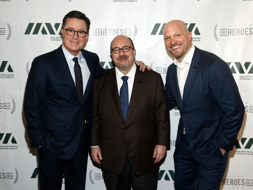 Talk show host Stephen Colbert (left), Craigslist founder Craig Newmark (center), and Iraq and Afghanistan Veterans of America CEO Paul Rieckhoff (right) pose for pictures at IAVA's 12th Annual Heroes Gala in New York City on Nov. 8, 2018. Rieckhoff is stepping down from his leadership role with the group after 14 years. (Brian Ach/Getty Images)