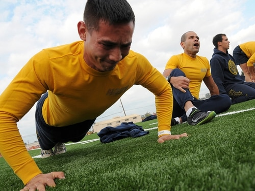 EO3 (SCW) Simon Charumonta, assigned to Naval Mobile Construction Battalion 3, finishes strong during the push-up portion of the physical fitness assessment at Naval Base Ventura County in July 2017. (MC1 Chris Fahey/Navy)