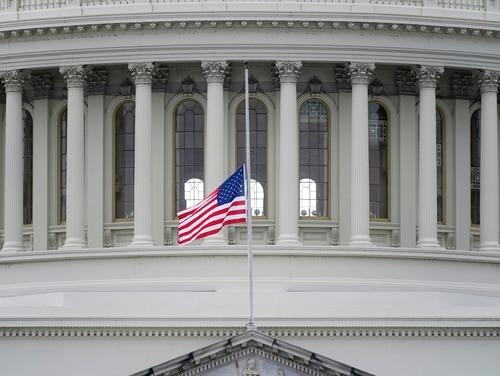 An American flag flies at half-staff in remembrance of U.S. Capitol Police Officer Brian Sicknick above the Capitol Building in Washington, Friday, Jan. 8, 2021. Sicknick died from injuries sustained as President Donald Trump's supporters stormed the Capitol. (Patrick Semansky/AP)