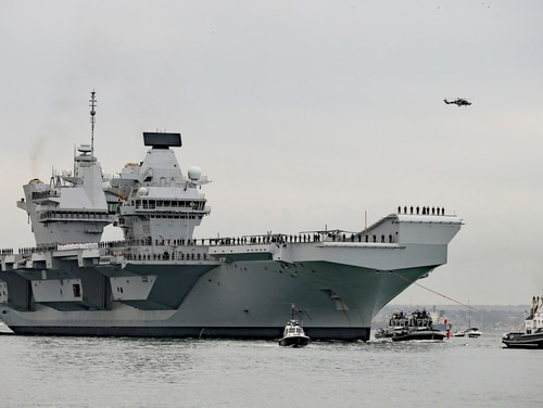The Royal Navy's newest carrier, along with her ready-to-get-hammered-drunk sailors, arrived on America's East Coast Wednesday after completing her maiden transatlantic voyage. (Steve Parsons/PA via AP)