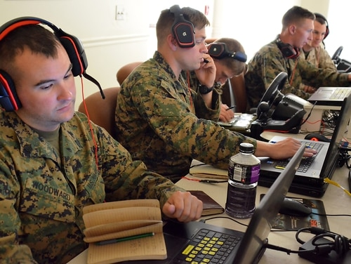 Members of Company K, 3rd Battalion, 25 Marine regiment, rehearse live-fire operations and practice call-for-fire missions using the Virtual Battle Space III (VBS III) simulator (Sgt. 1st Class Helen Miller/Army).