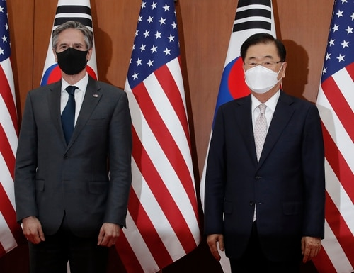U.S. Secretary of State Antony Blinken, left, and South Korean Foreign Minister Chung Eui-yong pose for the media before their meeting at the Foreign Ministry in Seoul, South Korea, March 17. (Lee Jin-man/Pool via AP)
