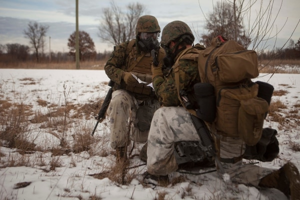 Marines with Marine Air Control Group 28 radio for a casualty evacuation as part of urban operations training during Ullr Shield on Fort McCoy, Wis., Jan. 20, 2018. (Sgt. Joselyn Jimenez/Marine Corps)