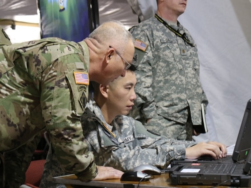 The Army is integrating cyber and electronic warfare planners into brigade staffs. (Kristen Kushiyama/Army)