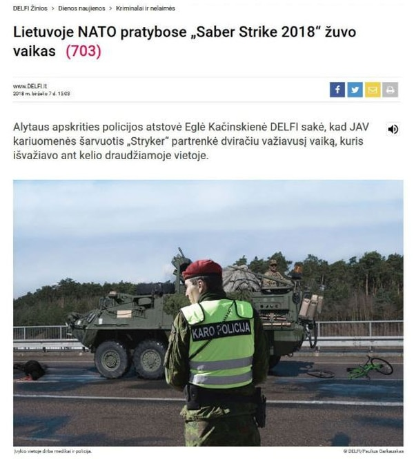A fabricated news story meant to look like a popular Lithuanian news outlet depicts a civilian killed by U.S. Army Strykers on a major roadway. Lithuanian officials denounced the photo as an attempt to divide the NATO alliance. (Screenshot via Gelezinisvilkassite)