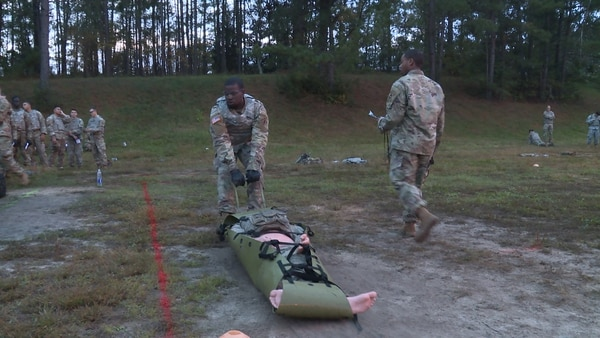 A soldier from the 264th Engineer Company at Fort Bragg, N.C., drags a 240-pound dummy as part of a recent trial of the new Soldier Readiness Test. The test, developed by Army Forces Command, is being tested and is pending final approval from Army leaders. (Daniel Woolfolk/Staff)