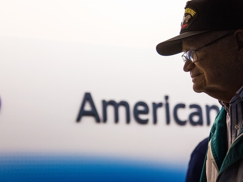 In this Sunday, Feb. 7, 2016 photo, Norwood Thomas, a 93-year-old World War II veteran, waits for his departure at the airport in Norfolk, Va. Thomas is embarking on a 10,500-mile journey to Australia to visit his wartime girlfriend after more than 70 years apart. (Hyunsoo Leo Kim/The Virginian-Pilot via AP) MANDATORY CREDIT