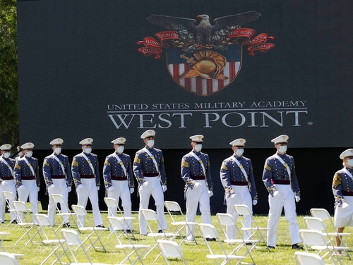 In this June 13, 2020, file photo, United States Military Academy graduating cadets, wearing face masks, march to their socially distanced seating during commencement ceremonies in West Point, N.Y. (John Minchillo/Pool via AP)