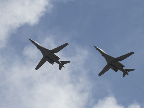 Two B-1B Lancers, assigned to the 28th Bomb Wing from Ellsworth Air Force Base, S.D., conduct a flyover before landing at Andersen Air Force Base, Guam, July 17, to conduct a bomber task force mission. (Airman 1st Class Christina Bennett/Air Force)