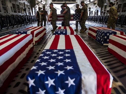The remains of eight service members whose bodies were recovered after a July 30, 2020, Marine AAV accident are transferred to Dover Air Force Base in Delaware in August 2020.