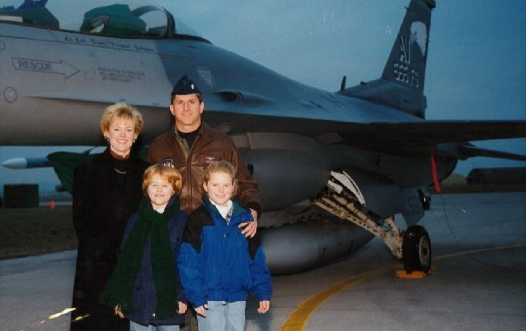 Lt. Col. Dave Goldfein is joined by, from left, his wife, Dawn, and daughters Diana, left, and Danielle, right, on the flight line at Aviano Air Base, Italy, in 1998. (Courtesy photo)