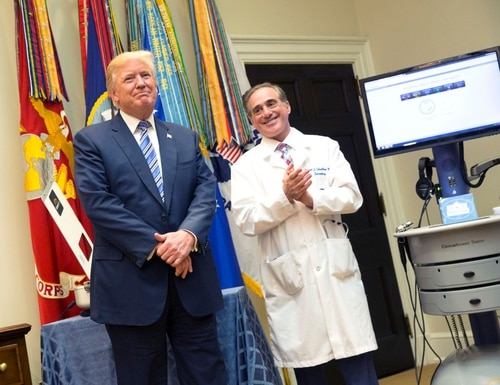 President Donald Trump listens to applause with then Veterans Affairs Secretary Dr. David Shulkin during a presentation at the White House on Aug. 3, 2017. (Chris Kleponis/Getty Images)