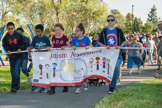Troops and family members participate in the Autism Awareness Walk at Travis Air Force Base, Calif., in 2017. World Autism Awareness Day is April 2. (Louis Briscese/Air Force)