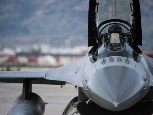 A pilot from the 480th Expeditionary Fighter Squadron prepares for flight in an F-16 Fighting Falcon fighter aircraft during a flying training deployment on the flightline at Souda Bay, Greece, Jan. 27, 2016. (Staff Sgt. Christopher Ruano/Air Force)