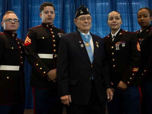 """World War II Medal of Honor recipient Hershel Woodrow """"Woody"""" Williams, a retired U.S. Marine, and U.S. Marines with Fleet Marine Force Atlantic, U.S. Marine Corps Forces Command, pose for a photo after the ship commissioning ceremony for the USNS Hershel """"Woody"""" Williams at the Half Moone Cruise and Celebration Center in Norfolk, Va., on March 7, 2020. (Cpl. Desmond Martin/Marine Corps)"""