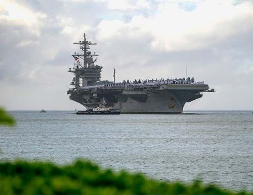 The aircraft carrier Abraham Lincoln arrives at Joint Base Pearl Harbor-Hickam on Jan. 8, 2020, as part of an around-the-world deployment that includes a home port shift to San Diego, Calif. (MC3 Aja B. Jackson/Navy)