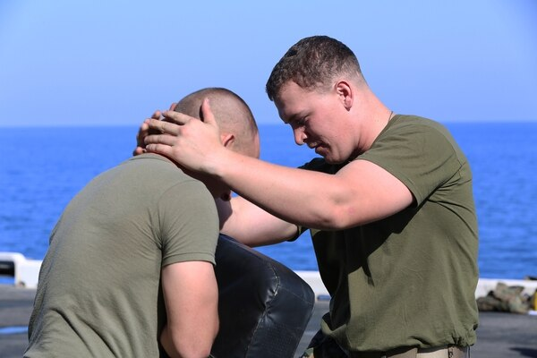U.S. Marine Corps Sgt. Adam Schoeller, right, Marine Medium Tiltrotor Squadron (VMM) 263 (Reinforced), 22nd Marine Expeditionary Unit (MEU), flight line mechanic and native of Gardners, Pa., controls his training partner Lance Cpl. Brandon Wilson, left, Battalion Landing Team 1st Battalion, 6th Marine Regiment, 22nd MEU, rifleman and native of Grand Prairie, Texas, during a Marine Corps Martial Arts Program training session aboard the USS Bataan (LHD 5), at sea, June 19, 2014. Elements of the 22nd MEU, embarked aboard Bataan, are operating in the U.S. 6th Fleet area of operations to augment U.S. Crisis Response forces in the region. (U.S. Marine Corps photo by Cpl. Caleb McDonald/Released)