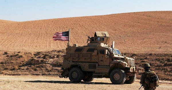 A U.S. soldier walks toward a tactical vehicle used to provide security during an independent, coordinated patrol outside Manbij, Syria, August 19, 2018. These patrols are coordinated with Turkish military forces to ensure the continued safety and security in Manbij. (Sgt. Nicole Paese/Army)