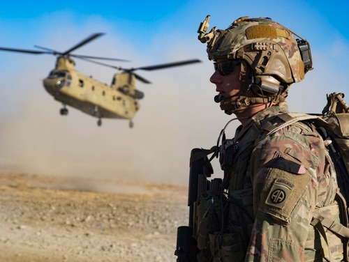 Army Staff Sgt. Jason N. Bobo helps secure the landing zone as a CH-47 Chinook helicopter lands for the extraction of coalition soldiers after a key leader engagement in southeastern Afghanistan. (Army)