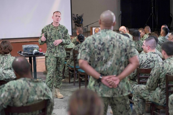 150603-N-OX801-381 CAMP LEMONNIER, Djibouti (June 3, 2015) Naval Forces Europe-Africa Fleet Master Chief Steven Giordano, left, answers a question from Master-at-Arms 1st Class Jose Soto at an all-hands call during Giordano's visit to Camp Lemonier in Djibouti, Africa. Giordano's visit to Camp Lemonnier and Combined Joint Task Force-Horn of Africa locations served to better understand the commands' quality of work and quality of life, as well as recognizing exemplary Sailors within each command. (U.S. Navy photo by Mass Communication Specialist 2nd Class Daniel P. Schumacher/Released)