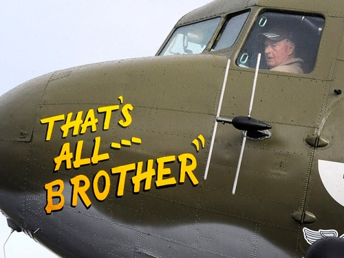In this April 9, 2019, photo, Pilot Tom Travis sits in the cockpit of the World War II troop carrier That's All, Brother during a stop in Birmingham, Ala. The C-47 aircraft, which led the main Allied invasion of Europe on June 6, 1944, is returning to the continent to participate in events marking the 75th anniversary of D-Day in June. (Jay Reeves/AP)
