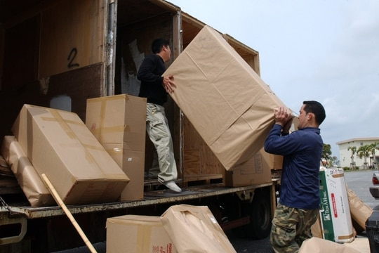 Protests have been filed which could delay a contract that will privatize the household goods move process. Here, movers pack up household goods at Kadena Air Base on Okinawa, Japan. (Senior Airman Jeremy McGuffin/Air Force)