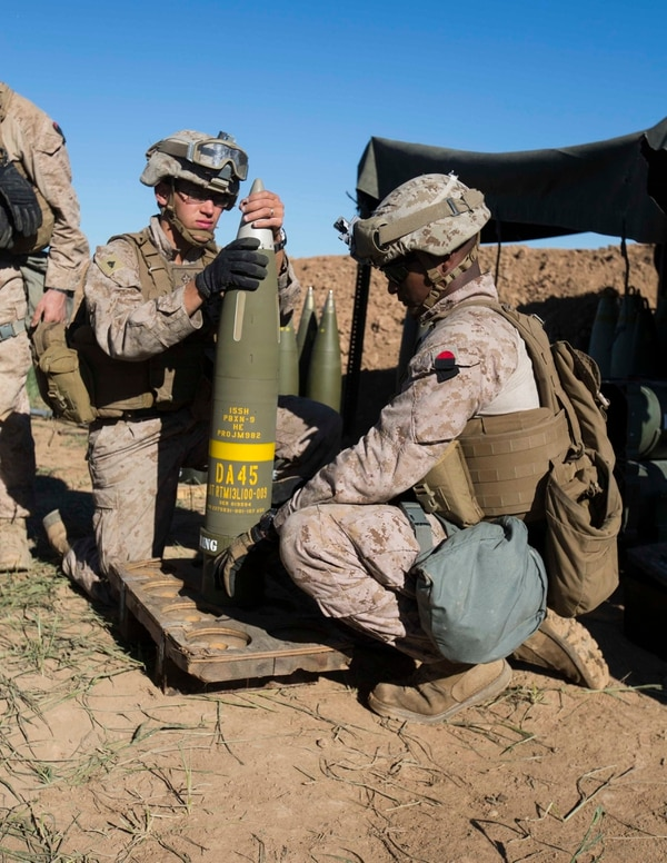 U.S. Marine Corps Cpl. Jordan Crupper, an artilleryman, and Sgt. Onesimos Utey, an artillery section chief, both with Task Force Spartan, 26th Marine Expeditionary Unit (MEU), prepare an Excalibur 155 mm round on Fire Base Bell, Iraq, while conducting fire missions against an Islamic State of Iraq and the Levant (ISIL) infiltration route March 18, 2016. Operation Inherent Resolve is an international U.S. led coalition military operation created as part of a comprehensive strategy to degrade and defeat ISIL. (U.S. Marine Corps photo by Cpl. Andre Dakis/Released)