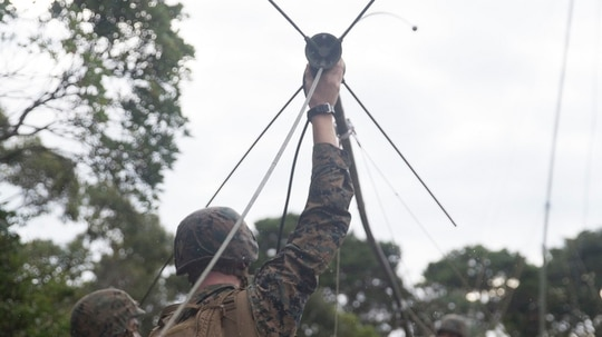 U.S. Marines raise an antenna as part of the setup for a week-long communications exercise at the Jungle Warfare Training Center in Okinawa, Japan, Oct. 16, 2018. Alpha Company, 7th Communication Battalion conducted the communications exercise to test their capabilities in providing communication services in field environments as well as train in jungle warfare tactics. (Pfc. Kindo Go/Marine Corps)