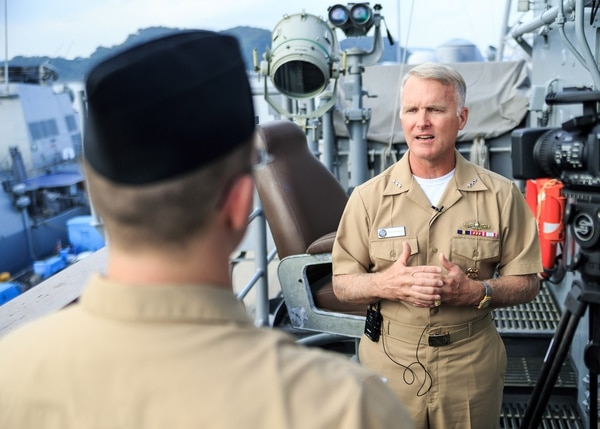 141009-N-NE138-087 YOKOSUKA, Japan (Oct. 9, 2014) - Vice Adm. Thomas Rowden, commander, Naval Surface Forces, U.S. Pacific Fleet, conducts and interview with an Armed Forces Network correspondent during a tour aboard the Ticonderoga-class guided-missile cruiser USS Shiloh (CG 67). Shiloh is assigned to Commander, Task Force 70, and is forward deployed in Yokosuka, Japan, in support of security and stability of the Indo-Asia-Pacific region. (U.S. Navy photo by Fire Controlman First Class Kristopher Horton/Released)