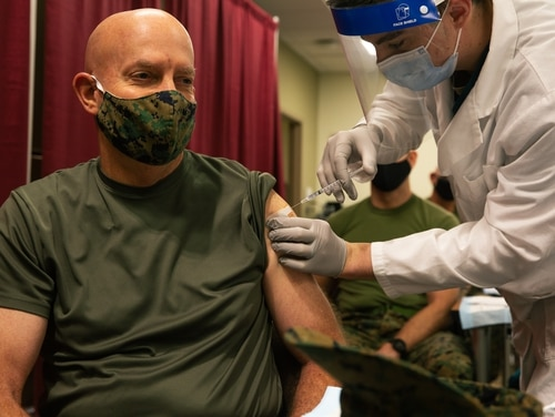 Commandant of the Marine Corps Gen. David H. Berger receives the COVID-19 vaccine as part of Operation Warp Speed at Walter Reed National Military Medical Center, Maryland, Dec 22, 2020. (Lance Cpl. Tyler W. Abbott/ Marine Corps)