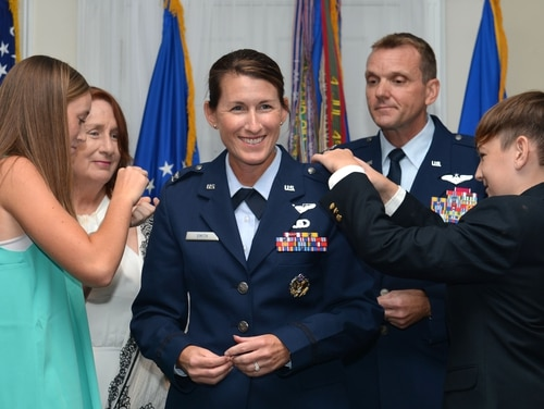 Newly promoted Col. Kristine Smith, deputy director for the 710th Combat Operations Squadron at Joint Base Langley-Eustis in Virginia, pins on her new rank in a July 2017 ceremony. Her husband, then-Col. Dustin Smith, who was chief of staff for U.S. Air Forces Central Command, conducted her promotion as his last official duty before retiring. The Air Force announced Wednesday that it has selected 517 officers for promotion to field grade ranks, including 445 promotions to colonel. (Senior Airman Christopher Maldonado/Air Force)
