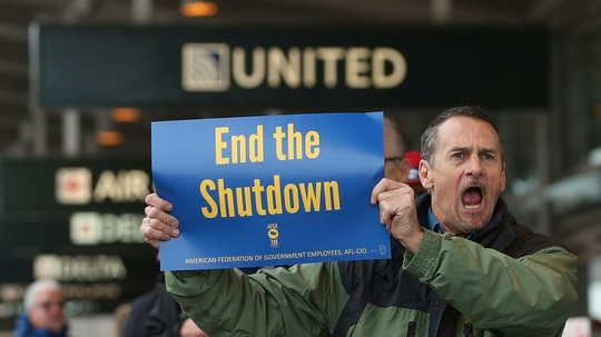 Several dozen federal employees and supporters demonstrated at the Sacramento International Airport calling for President Donald Trump and Washington lawmakers to end then partial government shutdown, Wednesday, Jan. 16, 2019, in Sacramento, Calif. (Rich Pedroncelli/AP)