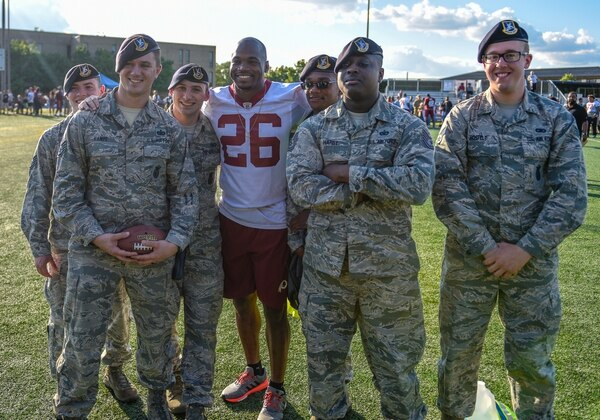 Newly-signed Redskins running back Adrian Peterson poses for a group photo with airmen Thursday at Joint Base Andrews. (J.D. Simkins/staff)