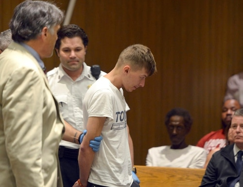 Volodymyr Zhukovskyy, 23, of West Springfield, is escorted into the courtroom for his arraignment in Springfield District Court June 24 in Springfield, Massachusetts. Zhukovskyy, the driver of a truck in a fiery collision on a rural New Hampshire highway that killed seven motorcyclists, was charged with seven counts of negligent homicide. (Don Treeger/The Republican via AP, Pool)