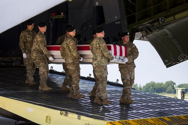 An Army carry team moves a transfer case containing the remains of Army Sgt. 1st Class Elliott J. Robbins, at Dover Air Force Base, Del., Tuesday, July 2, 2019. (Alex Brandon/AP)