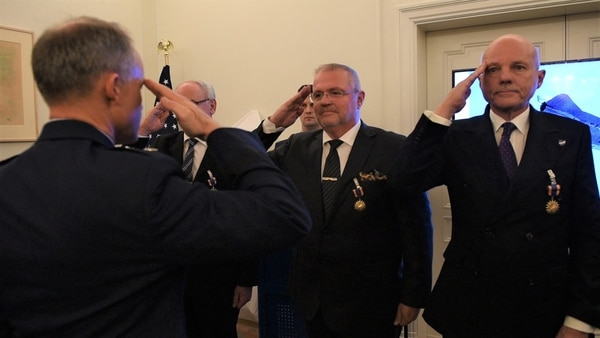U.S. Air Force Maj. Gen. John Williams salutes the Swedish pilots who were awarded the U.S. Air Medal in Stockholm, Sweden, Nov. 28, 2018. Gen. Williams thanked the four Swedish airmen who risked their lives to save an SR-71 and the aircrew in 1987. (Senior Airman Kelly O'Connor/Air Force)