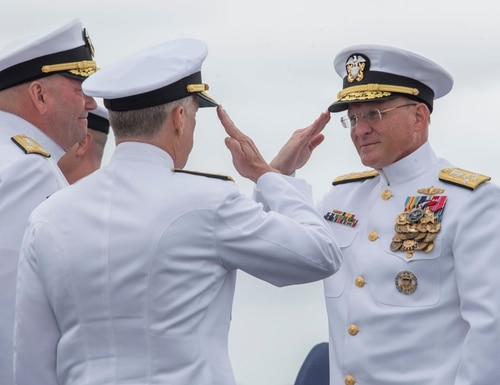 Vice Adm. Scott D. Conn, center, salutes Chief of Naval Operations Adm. Michael M. Gilday, right, after receiving command of U.S. 3rd Fleet during a change of command and retirement ceremony aboard the Nimitz-class aircraft carrier Theodore Roosevelt (CVN 71), Sept. 27, 2019. (Mass Communication Specialist 3rd Class Casey Trietsch/Navy)