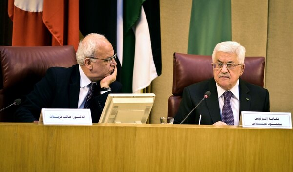 Palestinian president Mahmud Abbas (R) sits next to chief Palestinian negotiator Saeb Erekat during an Arab foreign ministers urgent meeting at the Arab League headquarters in the Egyptian capital Cairo on January 15, 2015 to discuss the Palestinian-Israeli conflict and the situation in Libya. AFP PHOTO / MOHAMED EL-SHAHED (Photo credit should read MOHAMED EL-SHAHED/AFP/Getty Images)