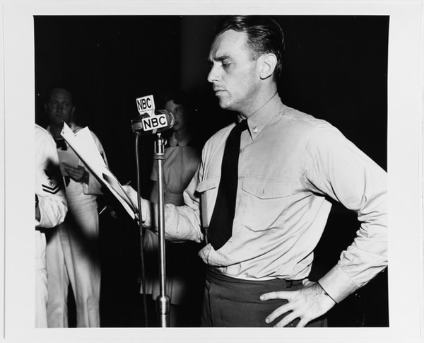 Lt. Cmdr. Douglas Fairbanks, Jr., making a radio broadcast, circa February 1945. (National Archives)