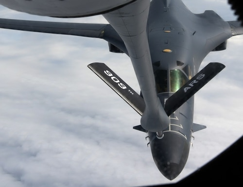 A U.S. Air Force KC-135 Stratotanker from the 909th Air Refueling Squadron at Kadena Air Base, Japan, prepares to refuel a B-1B Lancer over the South China Sea July 17. (Airman 1st Class Rebeckah Medeiros/Air Force)