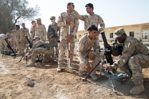 U.S. Soldiers assigned to Alpha Troop, 5th Squadron, 73rd Cavalry Regiment, 3rd Brigade Combat Team, 82nd Airborne Division, assist Iraqi soldiers assigned to the 73rd Brigade, 16th Division, with M224 60 mm mortar systems at Camp Taji, Iraq, June 25, 2015. By enabling Iraqi security forces through Advise and Assist and Building Partner Capacity missions, the Combined Joint Task Force – Operation Inherent Resolve's multinational coalition is helping the Government of Iraq to set the conditions to defeat the Islamic State of Iraq and the Levant. (U.S. Army photo by Spc. Paris Maxey, CJTF-OIR Public Affairs)