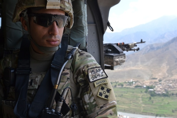 U.S. Army 1st. Lt. Florent A. Groberg, officer in charge for personal security detail, 4th Brigade Combat Team, 4th Infantry Division enjoys the view from a UH-60 Black Hawk helicopter traveling over the Kunar province July 16, 2012.