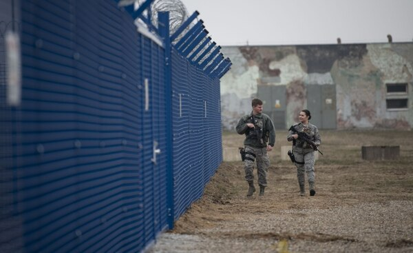 U.S. Air Force security forces with Detachment 2 patrol the fence line of a secured processing center at Miroslawiec Air Base, Poland, Feb. 28. (Senior Airman Preston Cherry/Air Force)