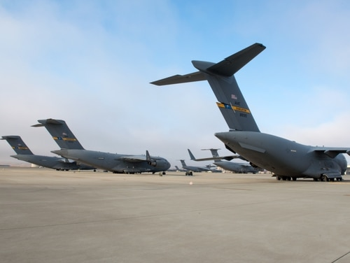 Three C-17 Globemaster IIIs from Joint Base Charleston, South Carolina, sit on the tarmac at Travis Air Force Base, California., on Sept. 8. They were staging at Travis because of Hurricane Irma. (Louis Briscese/Air Force)