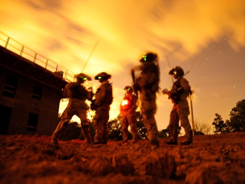 A squad of Navy SEALs participate in special operations urban combat training at an undisclosed location. (Petty Officer 2nd Class Meranda Keller/U.S. Navy via AP)
