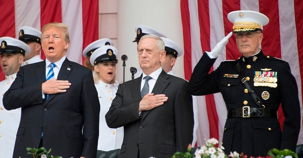 President Donald Trump, with Secretary of Defense Jim Mattis and Chairman of the Joint Chiefs Gen. Joseph Dunford, stand for the national anthem during a Memorial Day ceremony at Arlington National Cemetery May 28, 2018. Trump on Saturday named Gen. Mark Milley to be Dunford's successor. (Jim Watson/AFP/Getty Images)