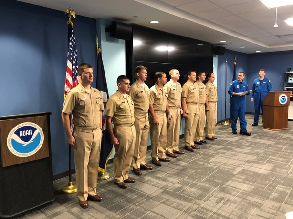 On Oct. 1, the NOAA Aircraft Operations Center held a pinning ceremony for NOAA Commissioned Officer Corps officers promoting to the next grade. In the middle, Lt. Samuel Urato put on lieutenant commander. (NOAA)
