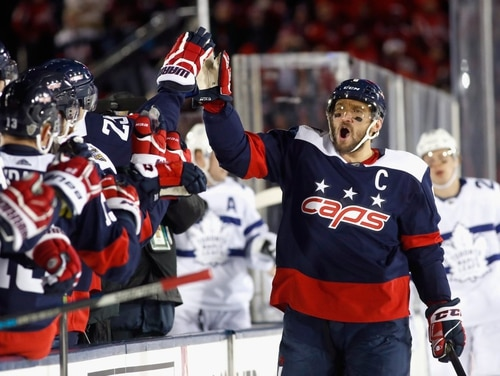 Capitals captain Alex Ovechkin celebrates after putting the home team ahead early. The game was the first ever outdoor NHL game on a military installation. (NHL)